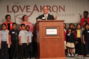 Mark Ford, executive director of The Love Akron Network, announced that Findley CLC students in North Hill (also pictured) are recipients of the organization's Adopt-a-School program.