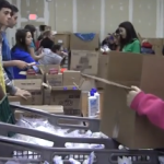 Volunteers and Salvation Army give back for Christmas (Video)
