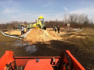UA Student Athletes volunteer time to Spring Garden Waldorf School and its students by spreading mulch on the playground.