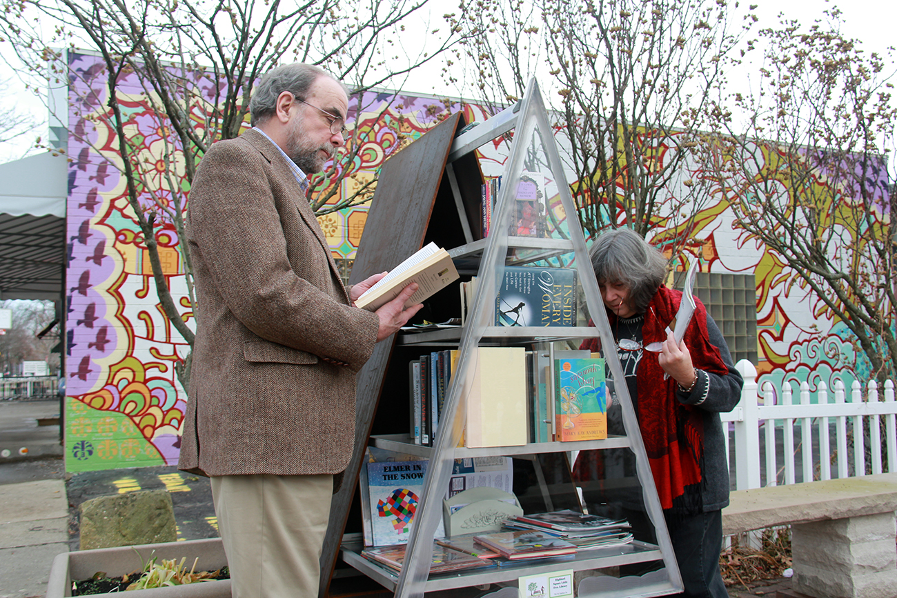 The free library in Highland Square is a lending library housed inside of a commissioned art piece. (Photo: Chris Miller)