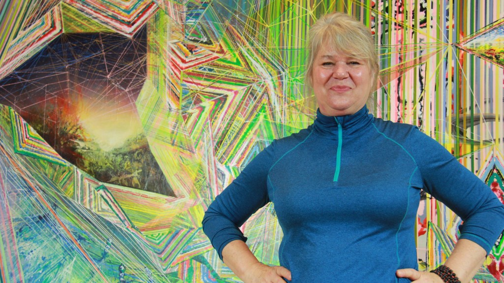 "Susan Chrysler White, exhibiting at the ""Beauty Reigns"" exhibit at the Akron Art Museum, draws upon Asia,  tribal cultures, the Bay Area in California and countries in between in her paintings to create symmetry, biological shapes folklore and personal experience. (Photo: Chris Miller)"