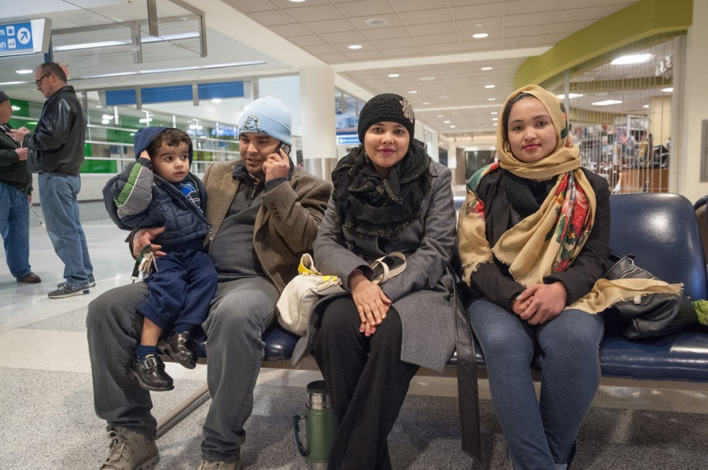 Rohit Biswa (left) came to the U.S. in 2010 after more than 20 years in Nepali refugee camps. He recently drove to the airport to pick up his remaining family members. (Photo: Dale Dong)