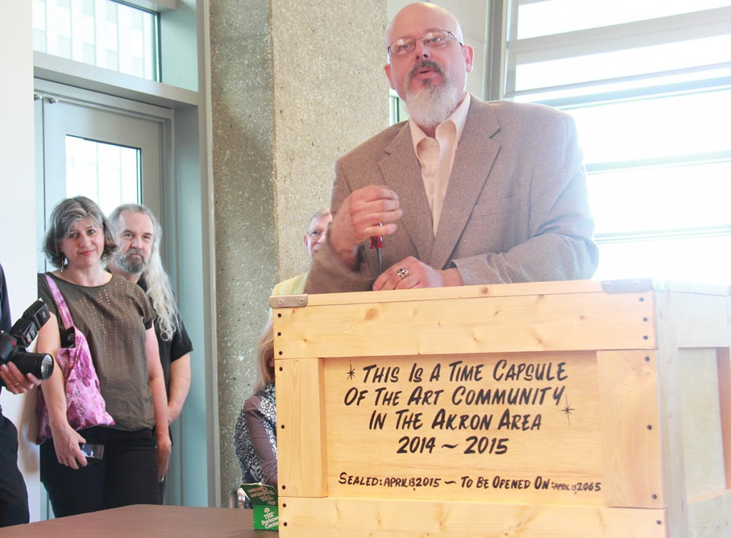 Local artist Terry Klausman has collected a year's worth of artifacts from the local art community into a time capsule that will be housed in the Special Collections Division of the Akron-Summit County Public Library. (Photo: Chris Miller)
