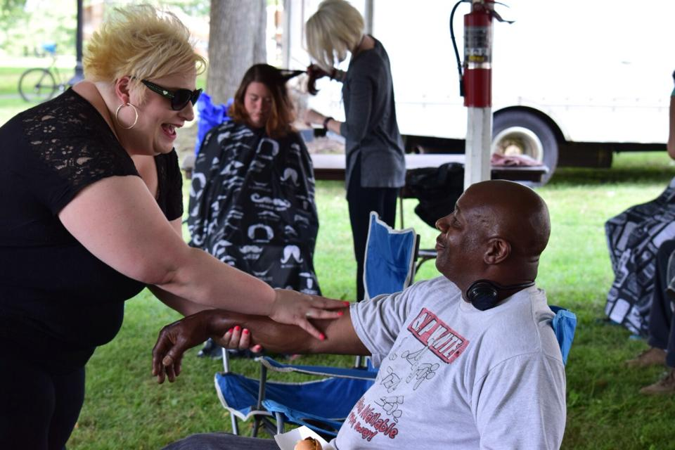 Last week, Akron Snow Angels handed out 200 gift bags to area homeless people, along with other services like free hair cuts and arm massages (provided by Gavin Scott Salon & Spa). (Photo courtesy of Akron Snow Angels)
