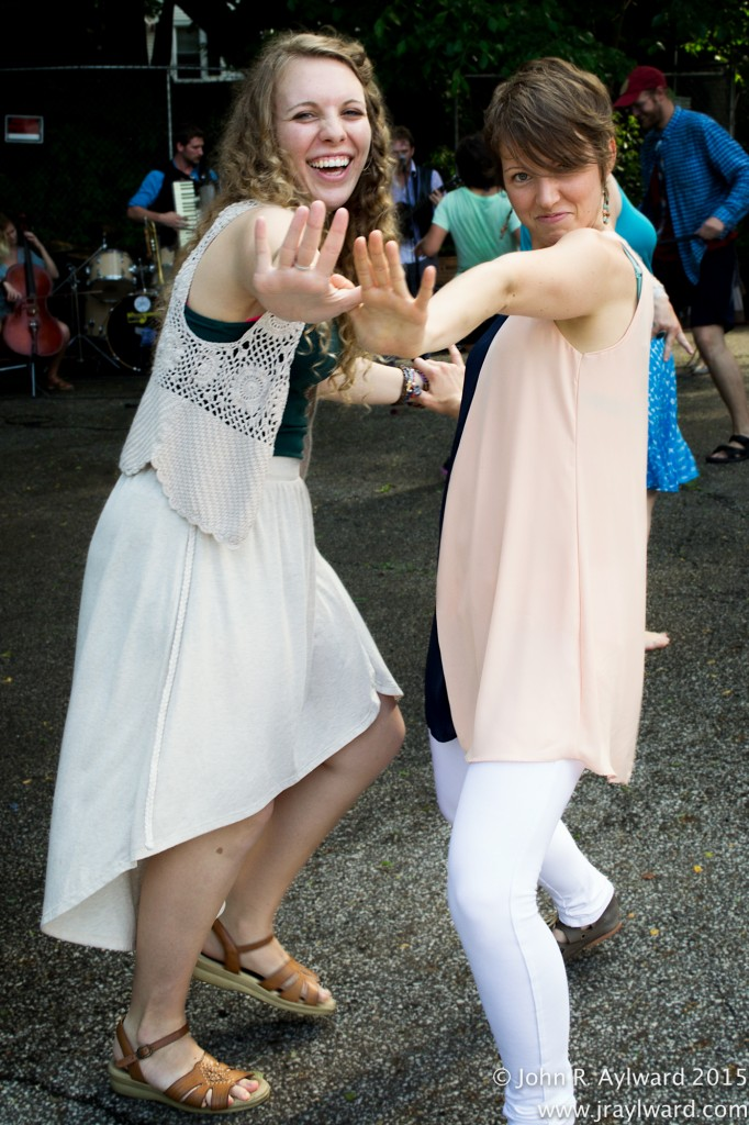 …Except that it got Kristie Lehay and this unknown woman dancing! The Help and the Hands got the whole crowd dancing in the streets. (Or parking lot, but the image still stands.) (photo: John R. Aylward)