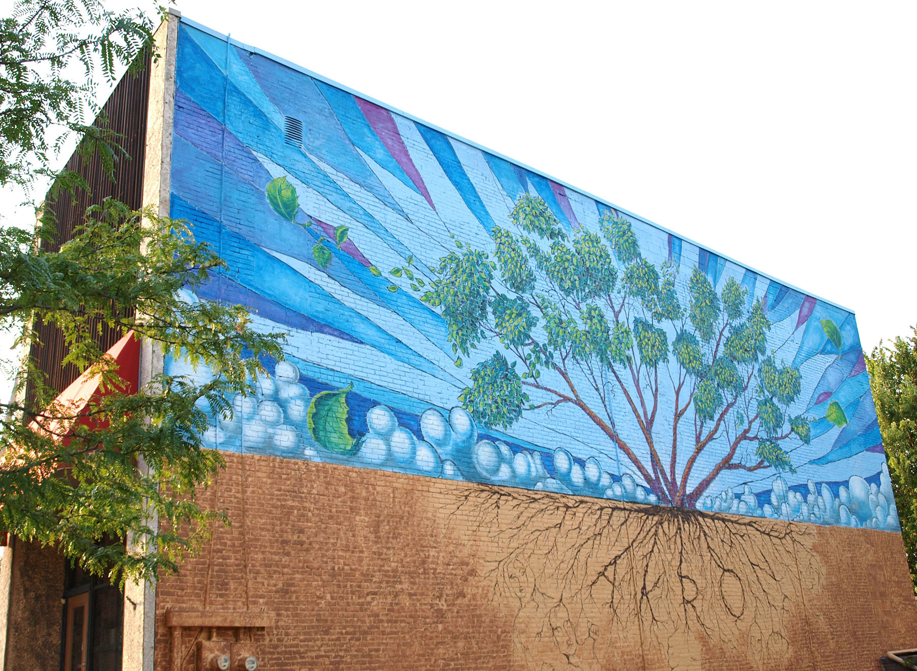 A mural adorns the outside of the Hazel Tree Interiors building.