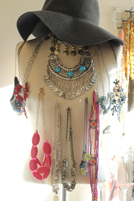 Craigslist bust form using pins to hang necklaces.