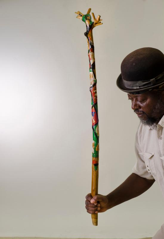 "Fredrick Shortridge won this year's Akron Art Prize with ""Afro Historical Family Tree,"" a hand-carved walking cane, symbolic of a family tree from roots to a budding child."