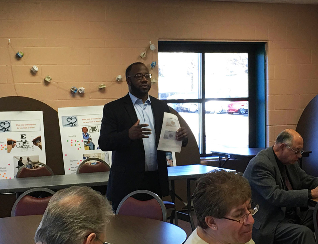 Chris Richardson, COO of AxessPointe Community Health Center, spoke with residents and officials about a proposed new health center in North Hill. (Photo: Chris Miller)