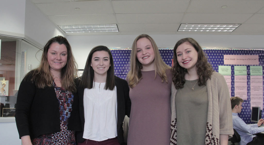 (From left) Barberton High School DECA Advisor Samantha Coldwell and her students Ashley Cook, Justine Liddle and Kathryn Ebner have helped unify Barberton's arts and entertainment district with the launch of the monthly Fourth Friday event, which kicks off Friday, Feb. 26 (Photo: Chris Miller)