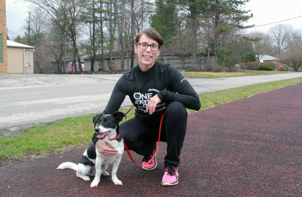 Beverly Dillon, who formed the local RunningDog Runners group, combines fitness and volunteering by incorporating shelter dogs into her training regimen, helping the shelter dogs become more adoptable. (Photo: Chris Miller)
