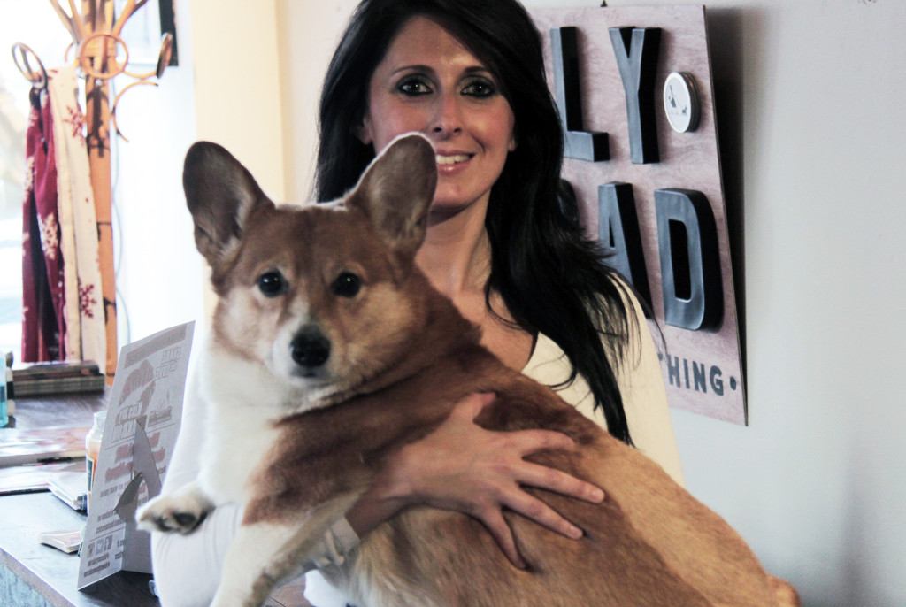 Suzie Pruitt, (pictured with her dog Huey Lewis Pruitt) recently moved back to Akron with her husband to launch Ely Road Boutique Clothing downtown. (Photo: Chris Miller)