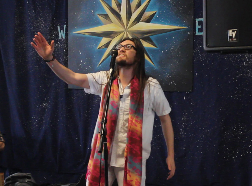 Kyle Jozsa, from theatre group Wandering Aesthetics, was one of many acts to grace the community stage on the second floor at Big Love, an all-day arts and music festival. (Photo: Vanessa Michelle)