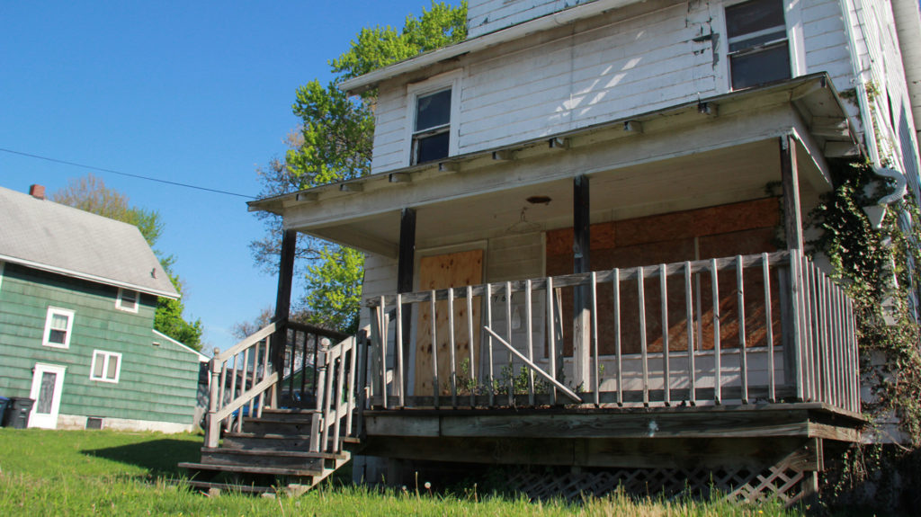 """As part of the Neighborhood Reborn project, some of the vacant houses will get a facelift via an """"artistic board-up"""" and others will get a preservation treatment from the East Akron Neighborhood Development Corp. (Photo: Chris Miller)"""