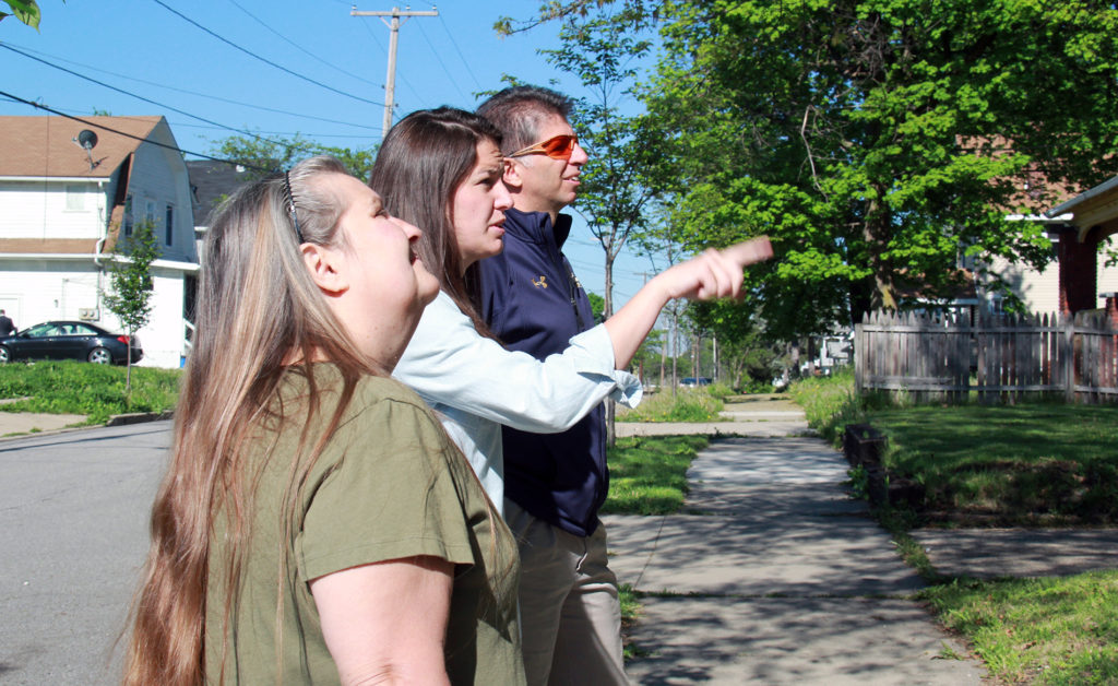 Marissa Blewitt and Eric Green, from Neighborhood Network of University Park, talk with resident Donna Christy about some of the improvements that will be made June 17 at the Neighborhood Reborn event. (Photo: Chris Miller)