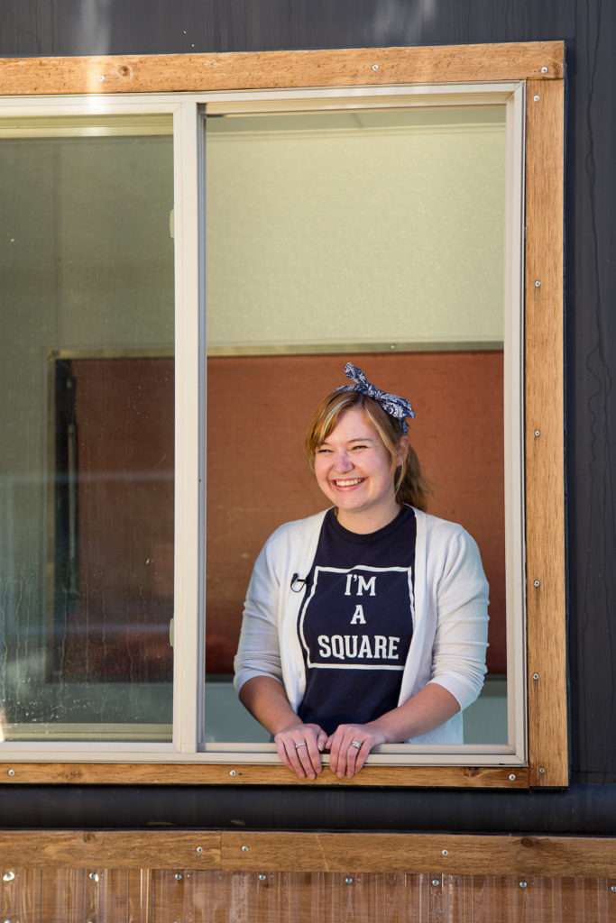 The Square Scullery food truck, run by Highland Square residents Heather (pictured) and Matt Ulichney is 27 feet long with a full-size kitchen. (Photo courtesy: Retro Peacock Photography)