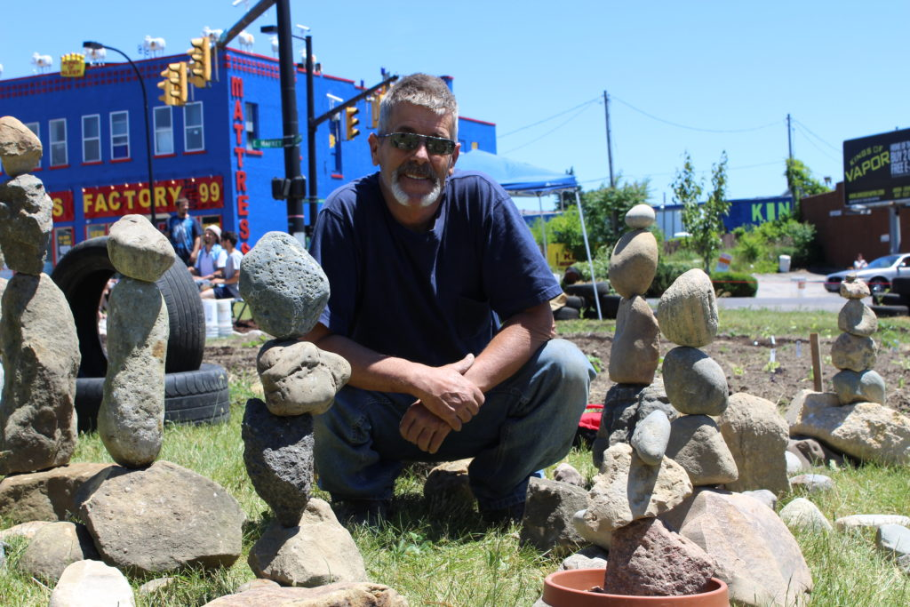 Rock stacking guru Ed Cote surrounded by the day's creations. Photo Credit: Yoly Miller