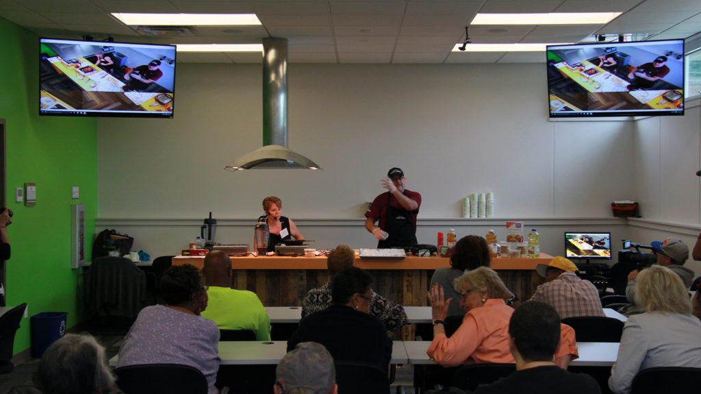 Hattie's Food Hub also features a community meeting space where food demos and cooking tutorials may help further educate residents, equipped with a kitchen and TV screens. (Photo: Chris Miller)