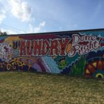 Downtown Laundromat unveils new mural created by Arts LIFT, Art Bomb Brigade