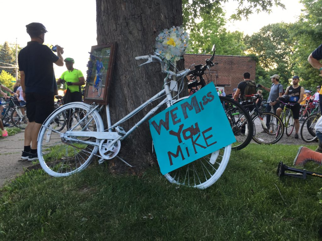 """Akron Bike Party's June ride paid tribute to Michael Finney, who was murdered last October while riding his bicycle. Group members made a """"ghost bike"""" in his honor. (Photo: Chris Miller)"""