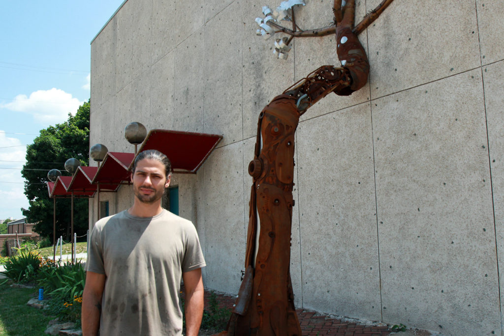 Sculptor Michael Marras used mainly recycled industrial materials to create this giant tree installation on the west wall of the Hazel Tree Interiors building. (Photo: Chris Miller)