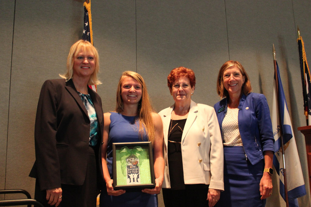 (From Left): Summit County Children Services Executive Director Julie Barnes; 2016 Russ Pry Youth Award Winner Maria Paparella; Summit County Executive Ilene Shapiro; and Summit County Juvenile Court Judge Linda Tucci Teodosio.