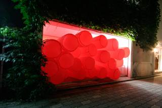 Artist Jimmy Kuehnle plans to install a bright red inflatable piece at the Akron Art Museum, which will fill one of the galleries and spill out into the lobby, inviting visitors to interact with it.