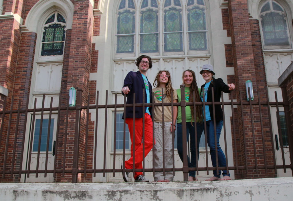 (From left) Zach Freidhof, Kely McHood, Caitlin Boyle and Beth Vild are the catalysts behind Love on Akron, a four-day event with live music, community discussions, yoga and other healing modalities at the Well Community Development Corporation, a former church on East Market Street. (Photo: Chris Miller)