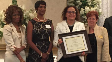 Judge Kathryn Michael of the Akron Municipal Court receives the Legacy III Humanitarian Award