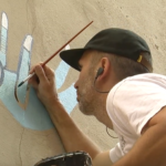 Skateboarder, illustrator leads Art Bomb Brigade mural