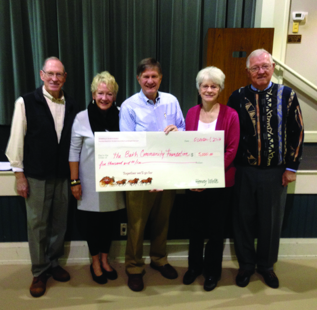 The Rev. Mark Frey, senior minister at The Bath United Church of Christ, and his wife, Margee, were surprised at the Oct. 1 Men's Breakfast at the church when they were given a check to create the Mark and Margee Frey Fund at Akron Community Foundation. With the Freys at the event were: (L-R) Roger Read, Bath Church member and founding donor of BCF; Jody Konstand, BCF Advisory Board chair; Mark Frey; Margee Frey; and Jim Bernard, Bath Church member and BCF Advisory Board member. (Photo courtesy: Tom Clark.)